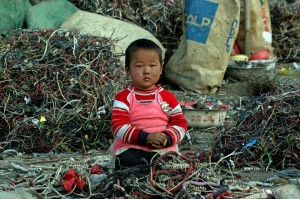 a-chinese-child-sits-amongst-landiflls