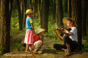Take your violin or a guitar. Sit under a tree. Start the play.