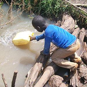 boy-gathering-water-cir